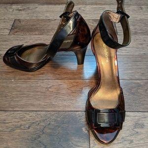 Never worn size 7 open toe tortoise pumps